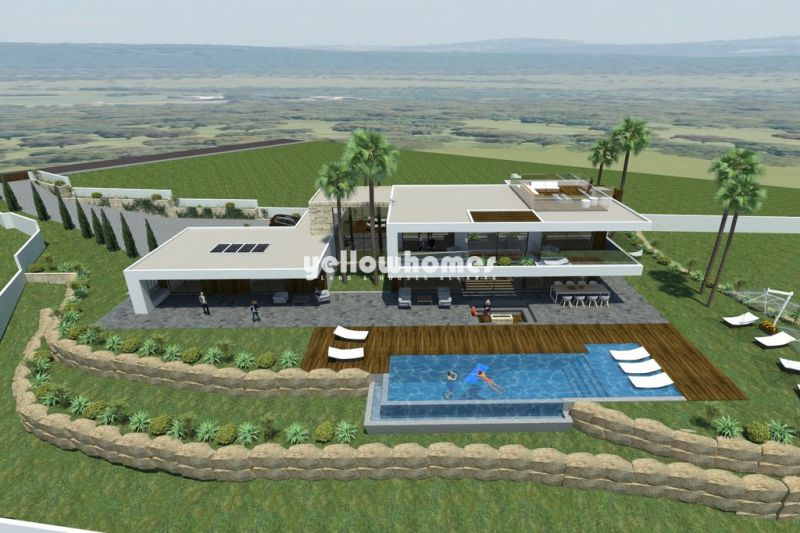 Large plot with project with great sea views near Loule